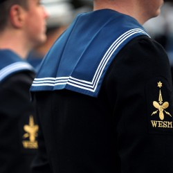Members of ballistic submarine HMS Vanguard's Port ship's company are pictured during during Divisions conducted at HM Naval Base Clyde in January 2013.