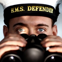 A sailor onboard Type 45 destroyer HMS Defender is pictured on the bridge of the ship.