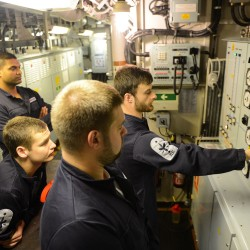 Members of the Marine Engineering department practise switchboard drills onboard HMS Northumberland.